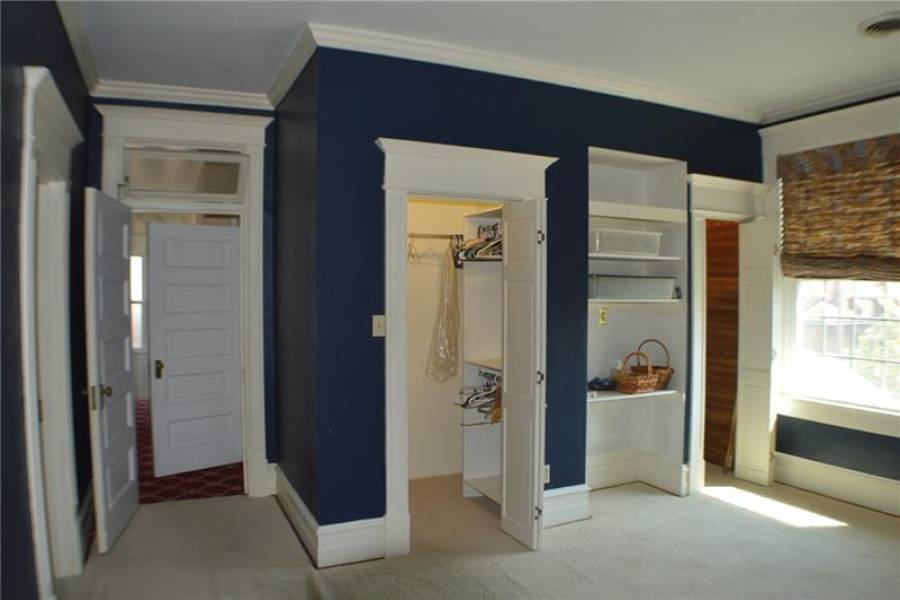 Blue bedroom has 2 closets, built-in bookcase and decorator FP
