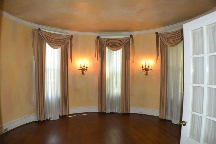 French doors into the round room on the first floor. Decorator FP, wall sconces.